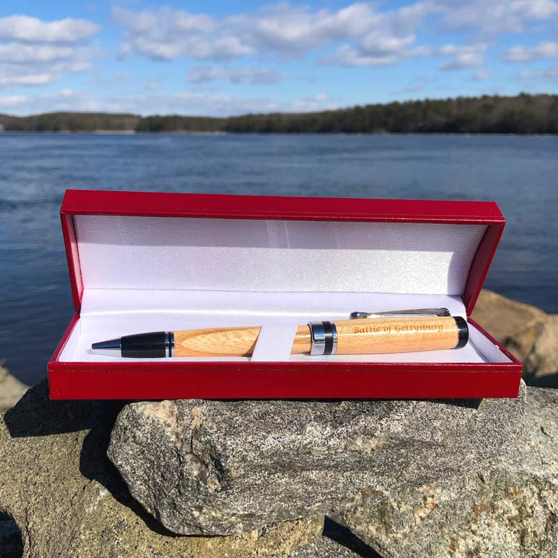 Battle of Gettysburg Pen, made from the Honey Locust Tree, laying in a red box by the ocean.