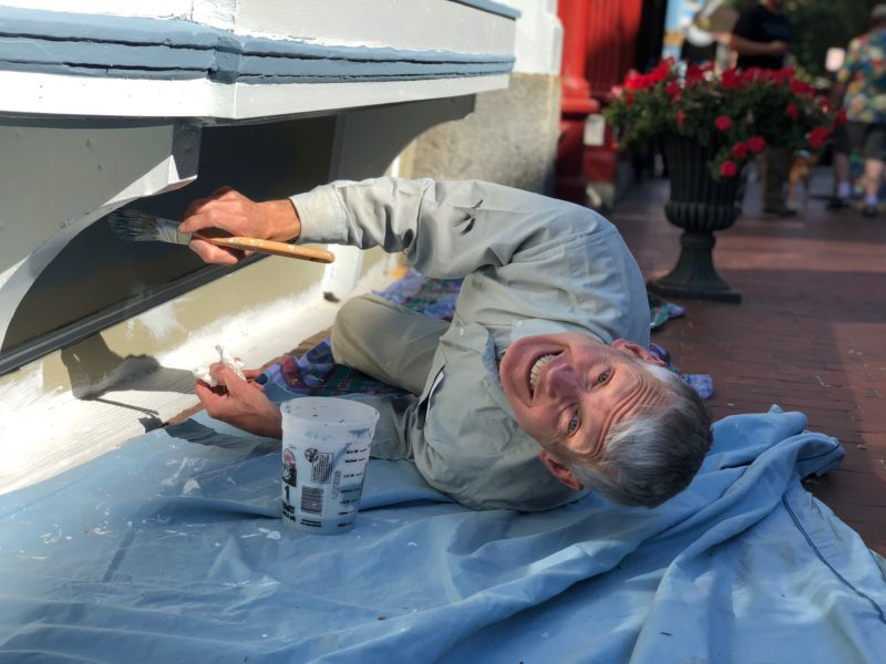 Andy Stewart, painting the storefront in Portland.