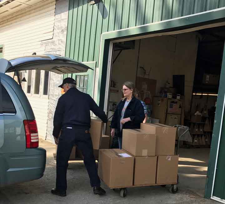 Andy loads large boxes filled with North Country Wind Bells into the Lisa-Marie's mobile.