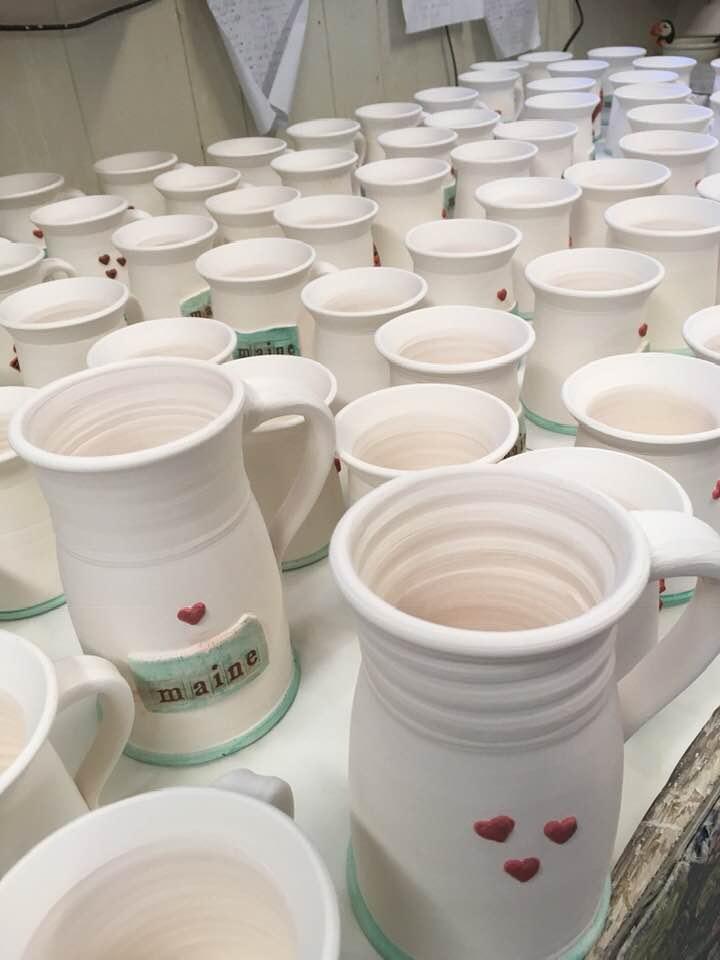 Maine and Heart mugs ready to be glazed