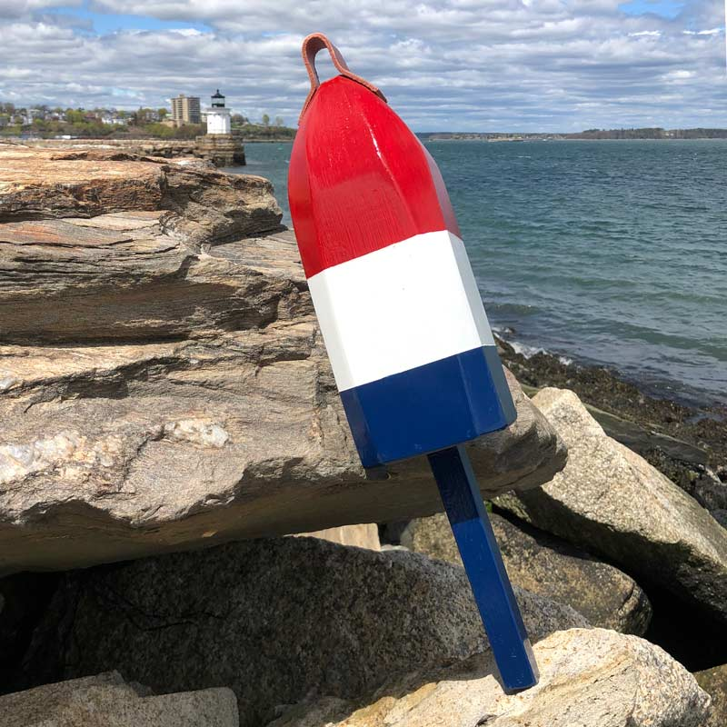 Large, Glossy, Red, White and Blue Buoy.