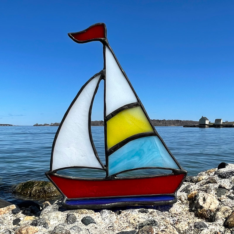 Yellow & Blue Sails on a Red Boat Stained Glass Sailboat