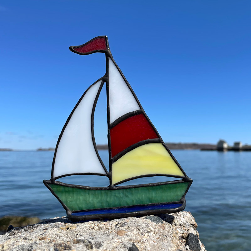 Red & Yelllow Sails on a Green Boat Stained Glass Sailboat