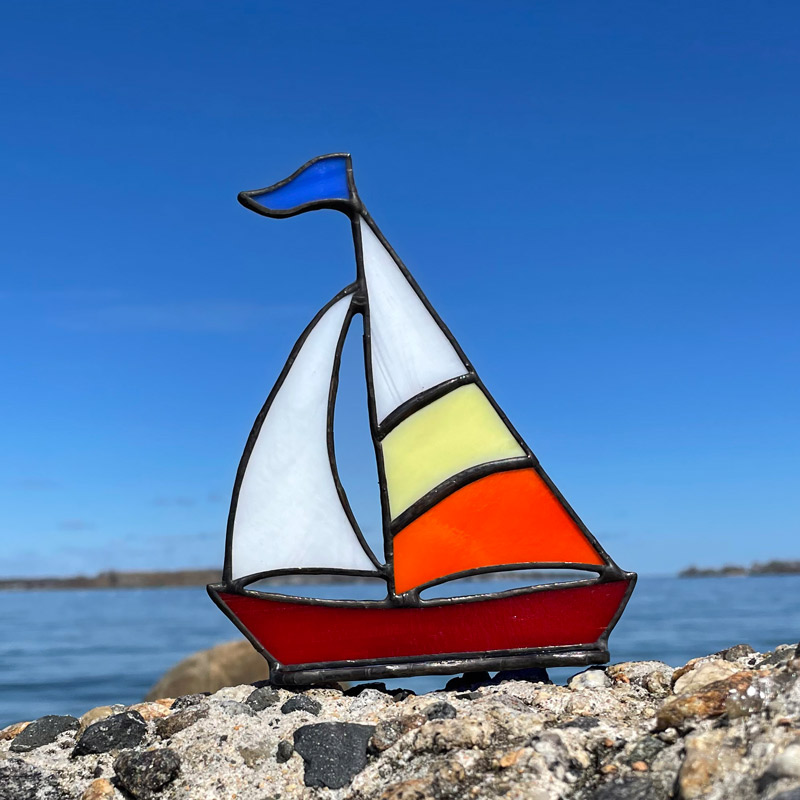 Yellow & Orange Sails on a Red Boat Stained Glass Sailboat