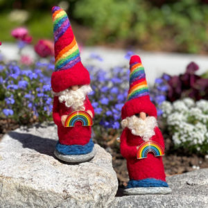"""~7"""" tall Rainbow Gnome wearing red and holding a Rainbow Pin"""